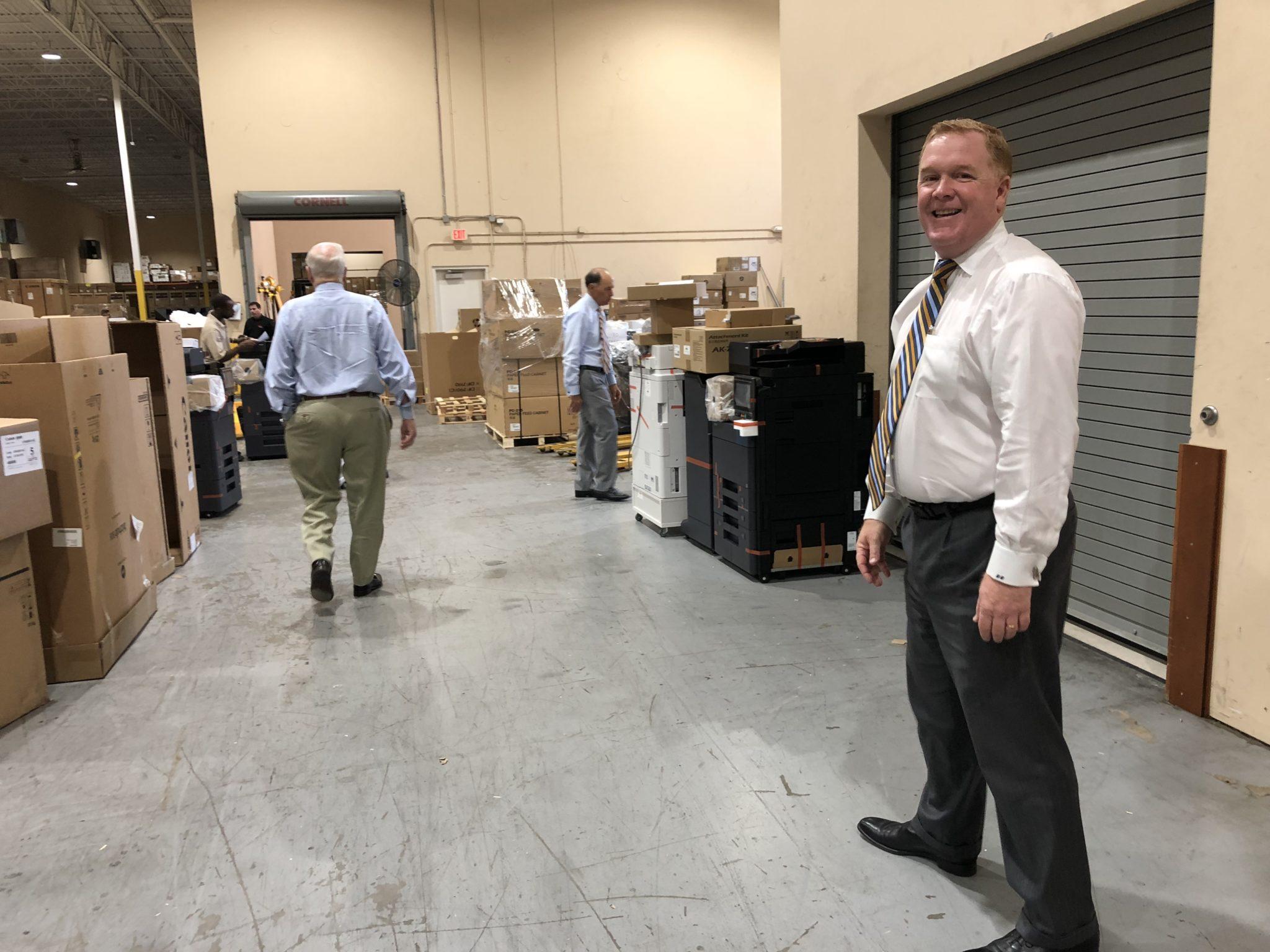 Dan Doyle Jr. walking through warehouse